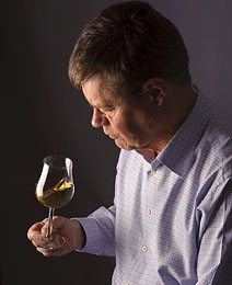 man_looking_at_glass_of_wine
