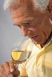 Man Smelling Homemade Wine