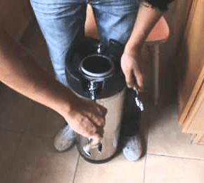 Man Working On Homebrew Keg