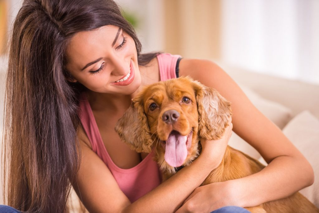 Woman hugging foster dog