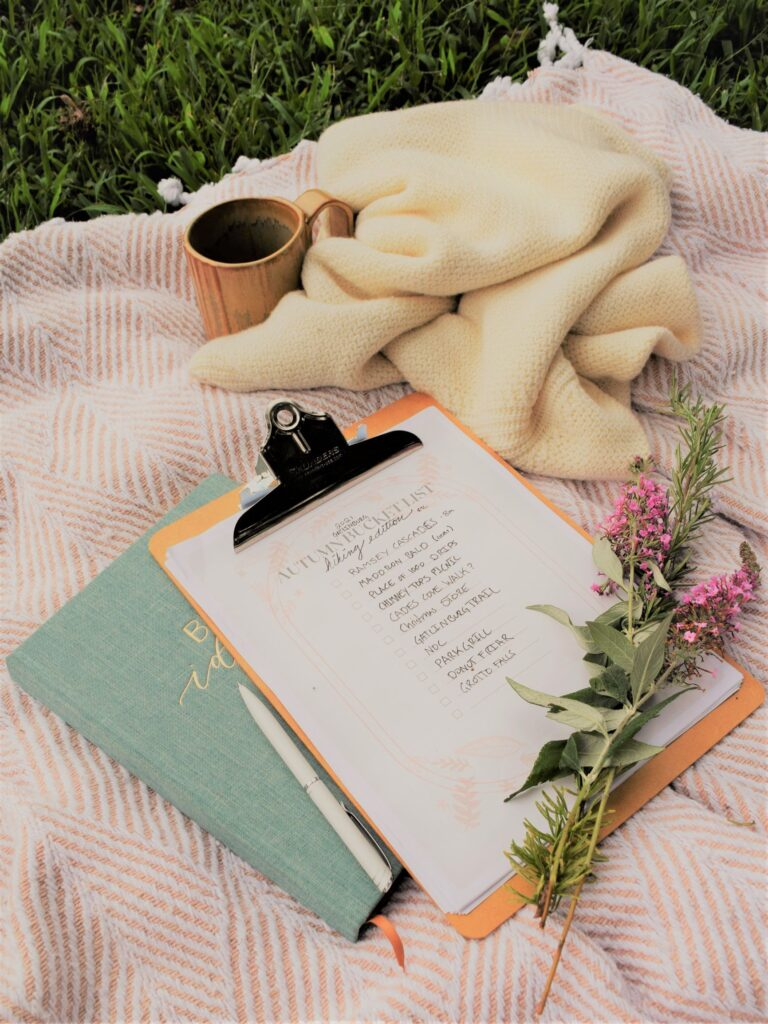 fall bucket list flowers on a blanket dreamy planning book picnic mug white sweater