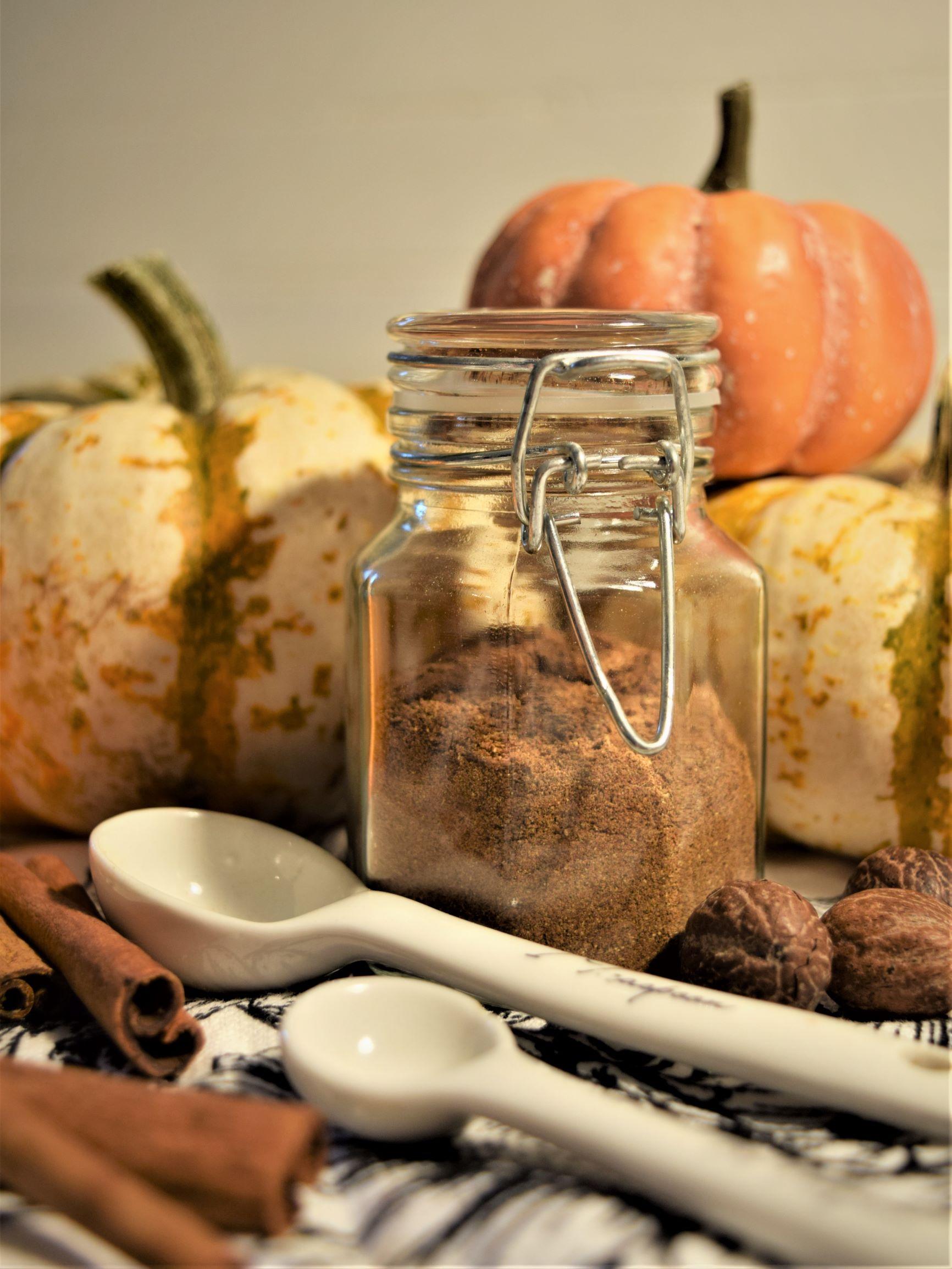 fall spice blend recipes pumpkin pie spice bottle autumn baking dessert spoon warm cozy kitchen