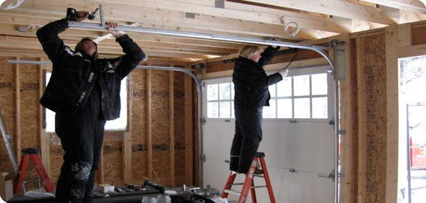 garage door being repaired by crew from Innovative Garage Door in Chicago