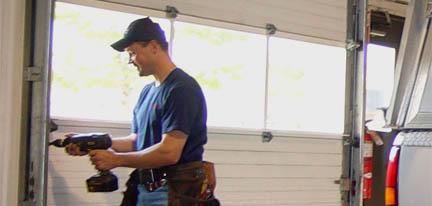 garage door being repaired by a man from Innovative Garage Door