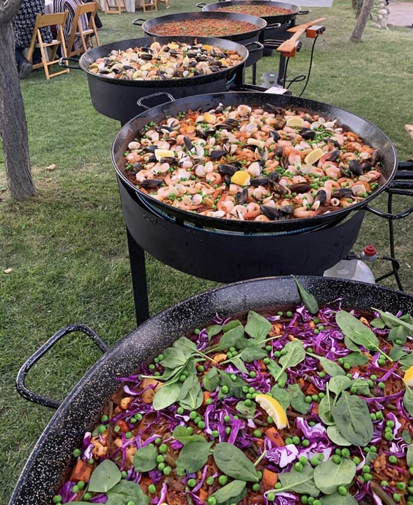 Paella is served from traditional pans.