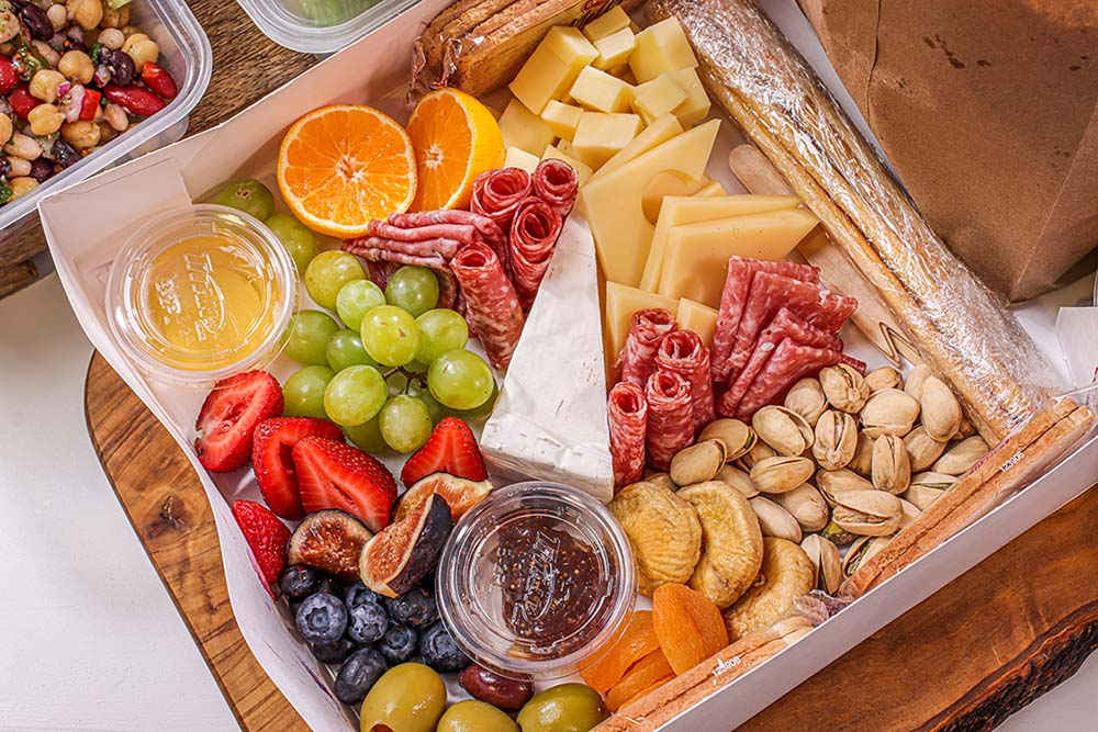 A popular grab-and-go option at Corbin Catering & Foods is artisan cheese and charcuterie in a box.