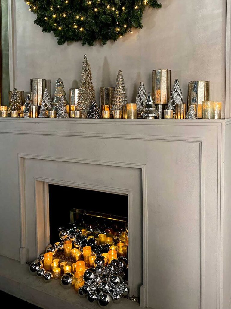 Filling a space with candles creates a warm ambience and cuts down on the expense of florals, says Nora Sheils, founder of Bridal Bliss and Rock Paper Coin. Photo courtesy of Eddie Zaratsian Lifestyle & Design