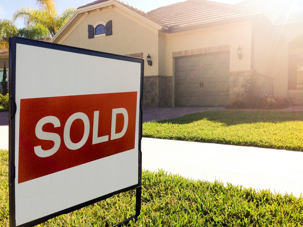 Sold sign in front of a Houston home
