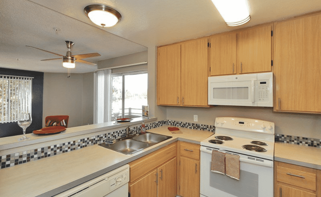 Kitchen with wood cabinets and white appliances