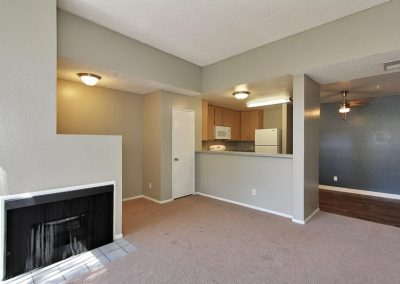 empty carpeted living room with fireplace