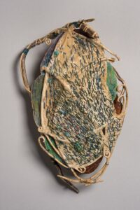 """Variations on a Shark's Purse ocean kelp, wax linen, pattern paper, turquoise stones 13"""" x 9"""" x 3"""" SOLD"""