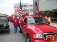 Doc saluting, Bob & Arnie getting ready for parade.jpg