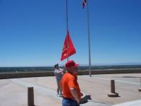 Pat Teague running up flag.JPG
