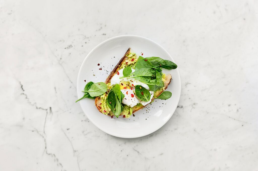 image of avocado toast on a marble surface