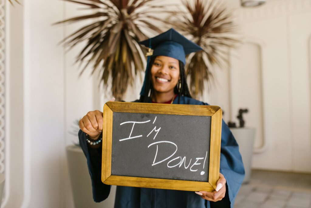 """photo of recent grad with """"i'm done"""" plaque"""
