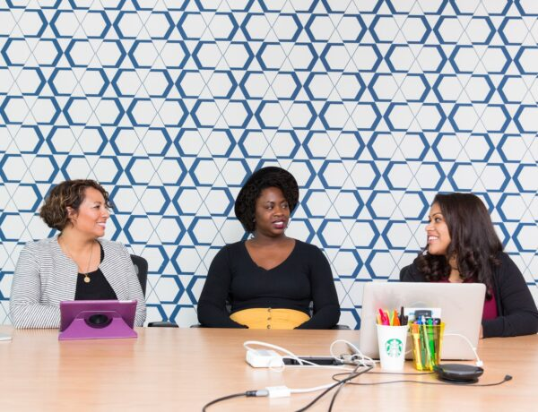 Women sitting around a conference table