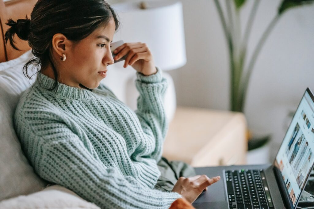 photo of a young woman on her laptop in in blog article about the importance of employers taking care of their employees in order to survive post pandemic shortage
