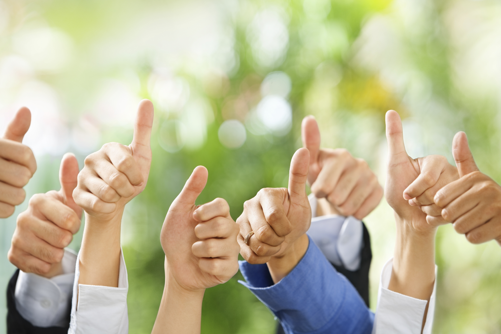 Thumbs up from diverse group of people on green background