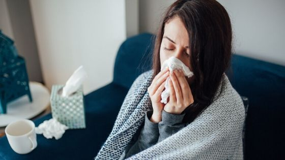 Sick young woman struggling with a cold.