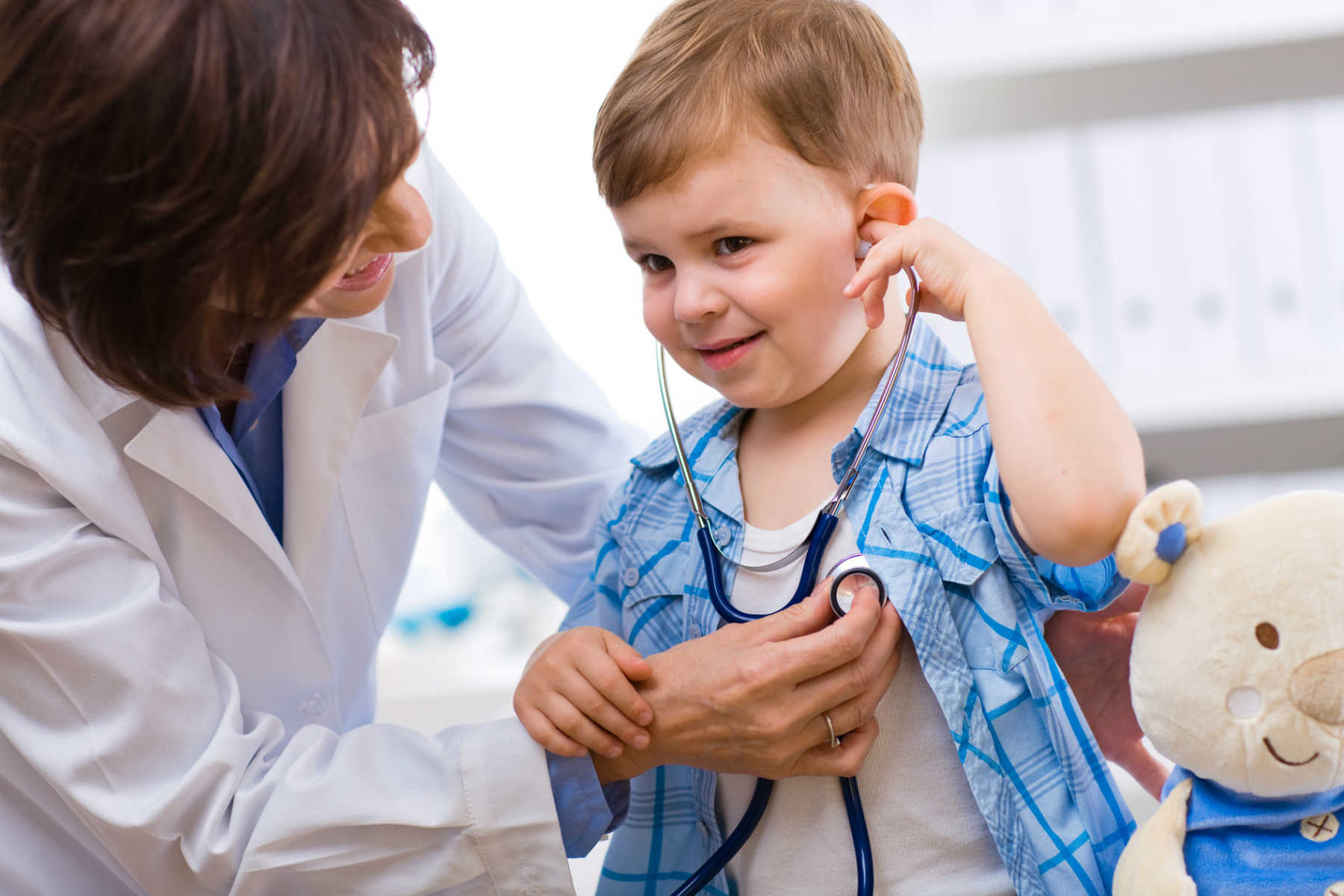 A child receiving medical care from a physician.