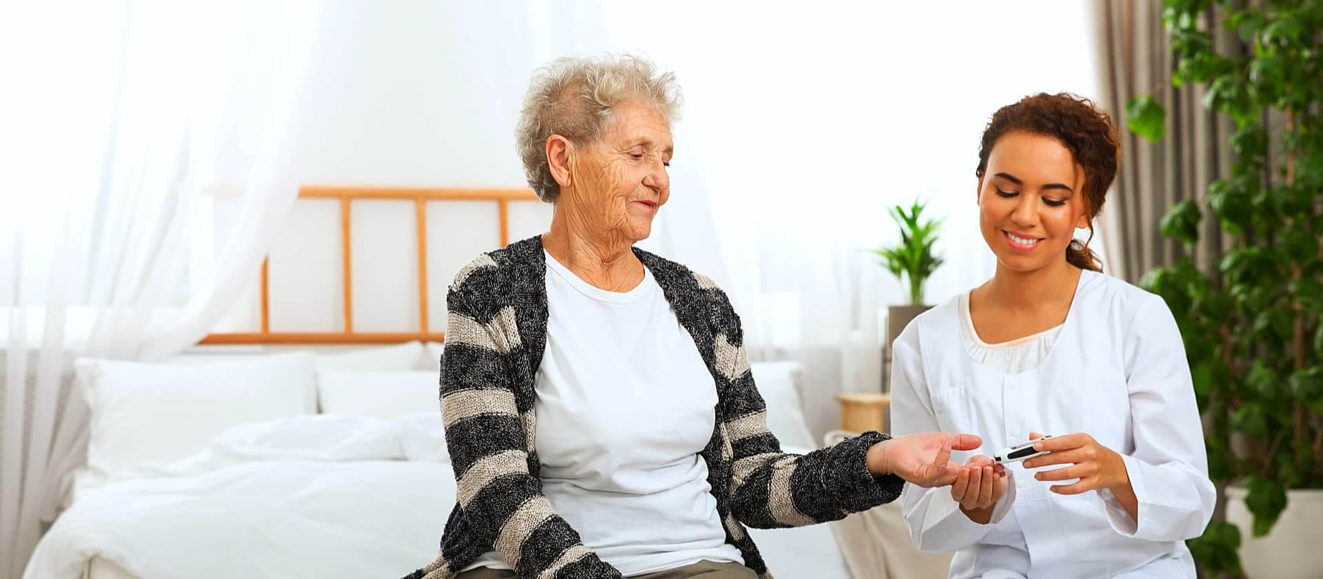 caregiver doing blood sugar monitoring