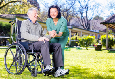 caregiver taking care of a senior man on wheelchair