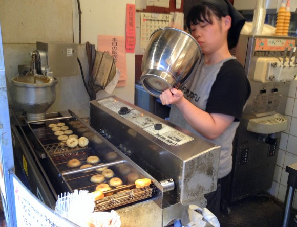 manning the donut fryer