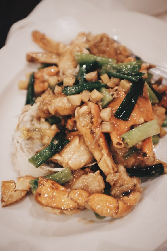 mud crab stir-fried in scallion and ginger