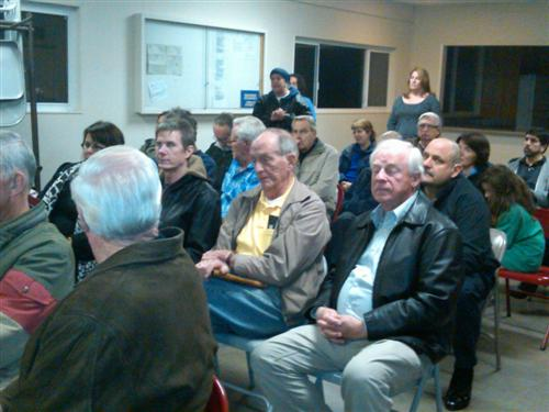 Neighbors listen - Neighborhood meeting to discuss explosion: more questions than answers