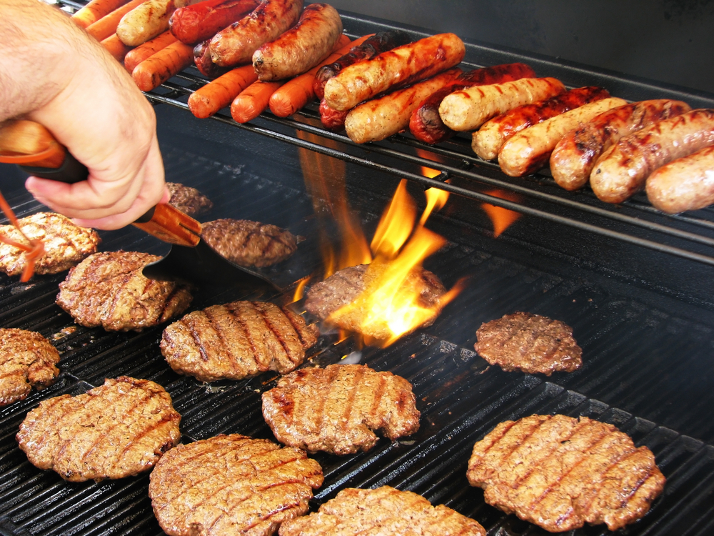 Photo of a Man Grilling Burgers in New Braunfels