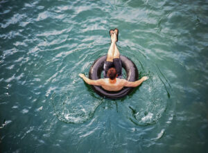 Picture of person tubing on the Comal River.