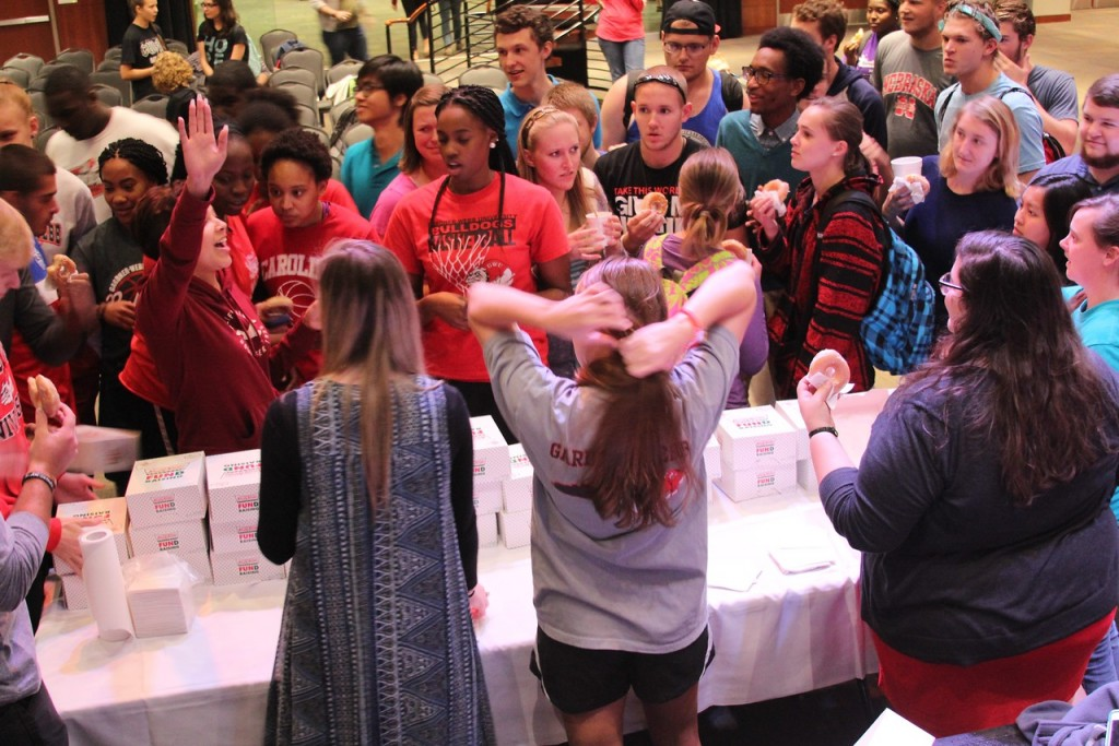 Students line up to receive their free donuts.