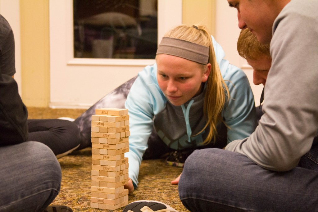 Student in deep concentration as she plays Jenga.