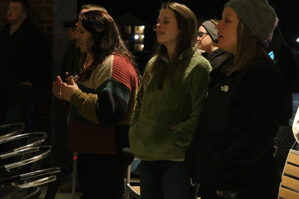 "From left: Brittney Kertesz, Ruth Anna Housand, and GWU Campus Ministries intern, Mindy Robinson worshipping to the song ""Lord I Need You."""
