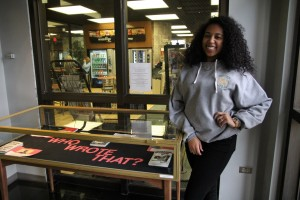 Meachem stands with her display in the library. Photo by Elizabeth Banfield
