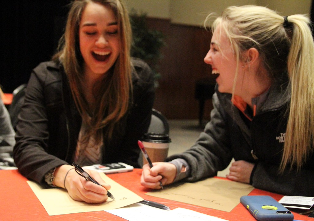 Freshmen laugh as they learn calligraphy at the release event Thursday, Feb. 25 night.