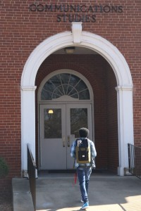 A student walks the ramp to enter into the Communication Studies Hall. Photo by Megan Hartman