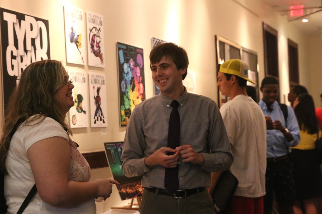 Graphic design major, Taylor Alexander, shares his work with family and friends.