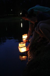 Taylor Schwartz and Giorgie Graves release their lanterns on the lake. Photo by Elizabeth Banfield
