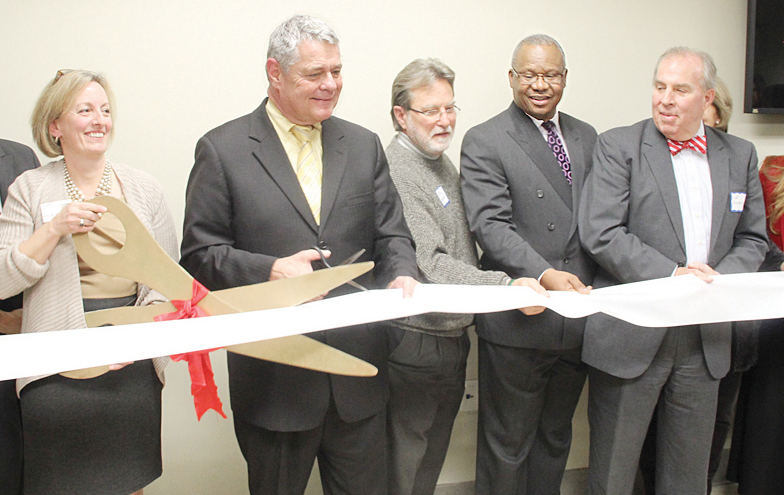 Eileen Lepro, executive director, New Horizons Healthcare, Mayor David Bowers, Councilman Bill Bestpitch, Rev.William Lee and Lee Wilham join in as the ribbon is cut to the new dental clinic at the facility on Melrose Ave.   photos by S. Hale