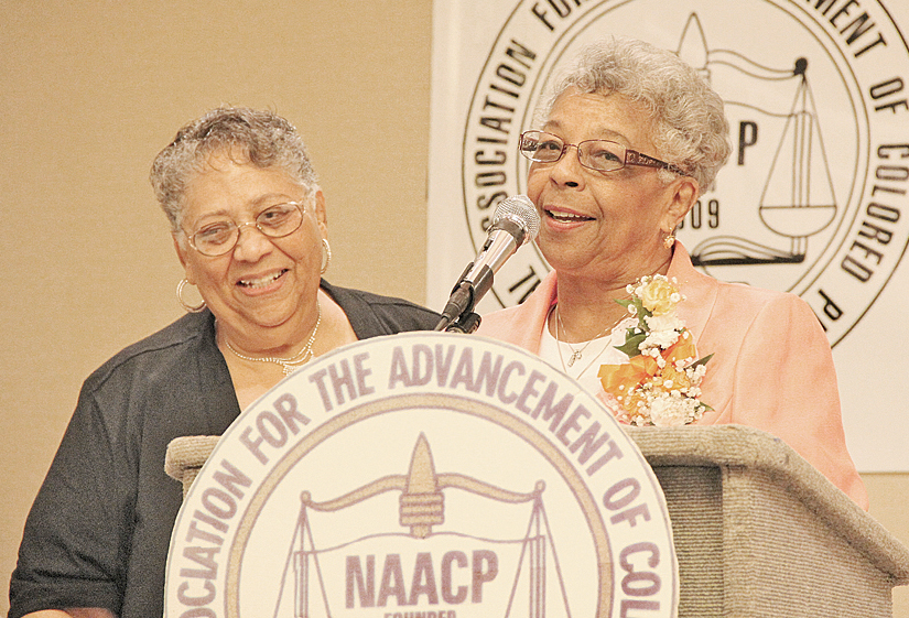 Women United for Community Action president Carolyn Patterson, receives The President's Award for the organization as local NAACP president Brenda Hale looks on.