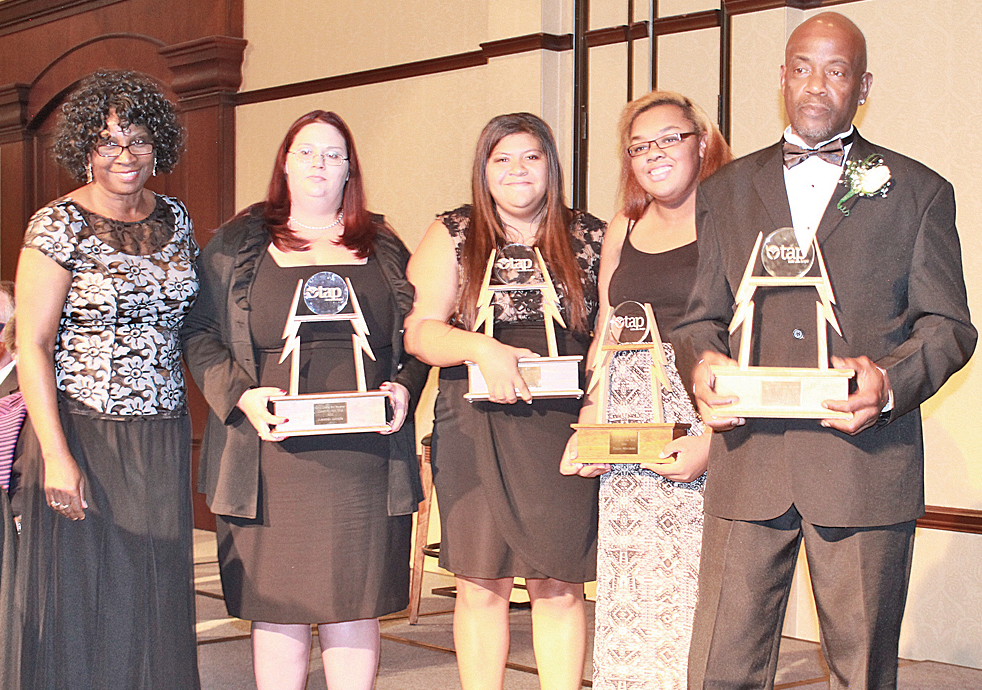 Honorees (from left): Tap President Annette Lewis with Amanda Lucado (education advocate); Tiyanu Merchant (TAP's first generation college program, Radford Univ.); Dyan Gaston–Grant (public speaker) and Dennis Leftwich (Marine Corps veteran) all recipients of TAP's Client of the Year Award.