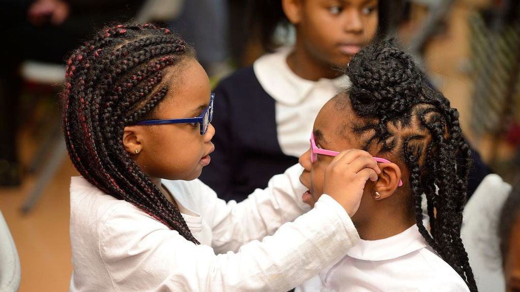 Girls were among the elementary school groups with the biggest gains in reading and math test scores after receiving eyewear through the Vision for Baltimore program, according to findings in a Johns Hopkins University study. (Will Kirk/Johns Hopkins University)