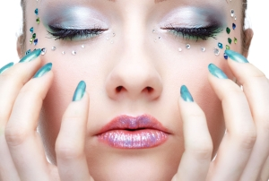 face-of-a-girl-with-makeup-and-manicure-33