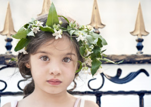 Little girl with ivy flowers