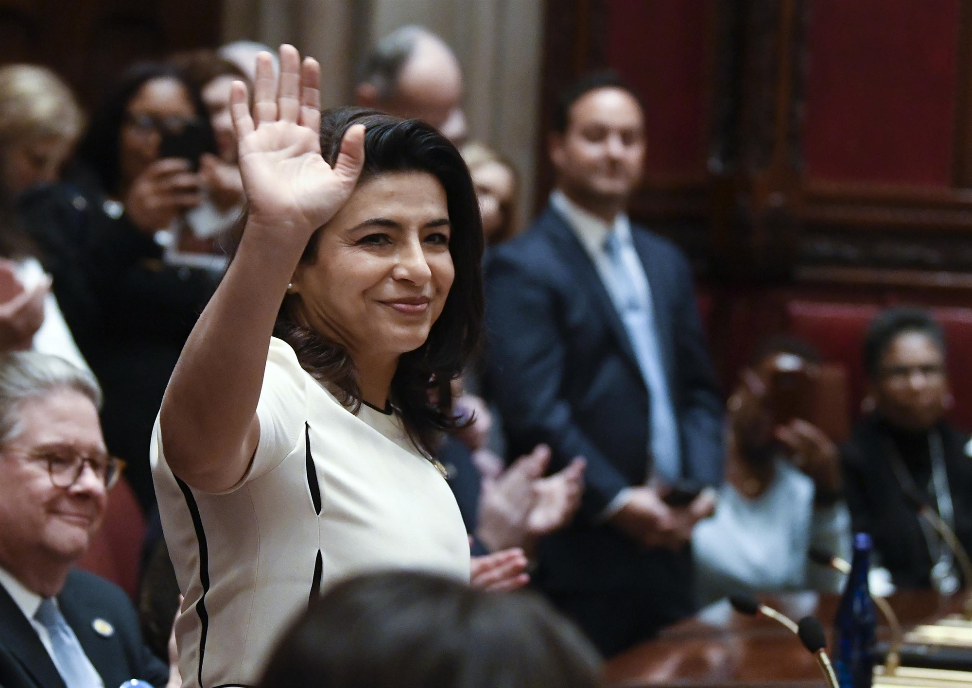 New York State Senator Anna Kaplan waves to colleagues in the Senate Chamber