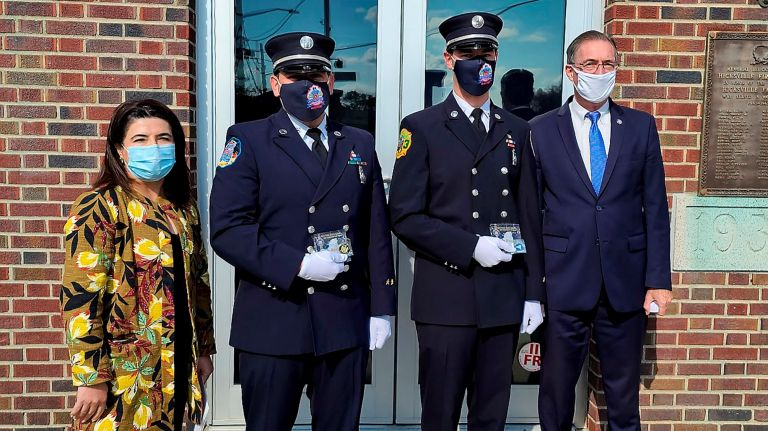 State Sens. Anna Kaplan (D-Great Neck) and James Gaughran (D-Northport), far right, with Hicksville Fire Department Capt. Christopher Moskos II, second from left, and Lt. Andrew Niemczyk on Sunday.  Credit: Office of Sen. Jim Gaughran/Marissa Espinoza