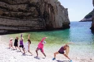 Group Beach Yoga, Reversed Warrior