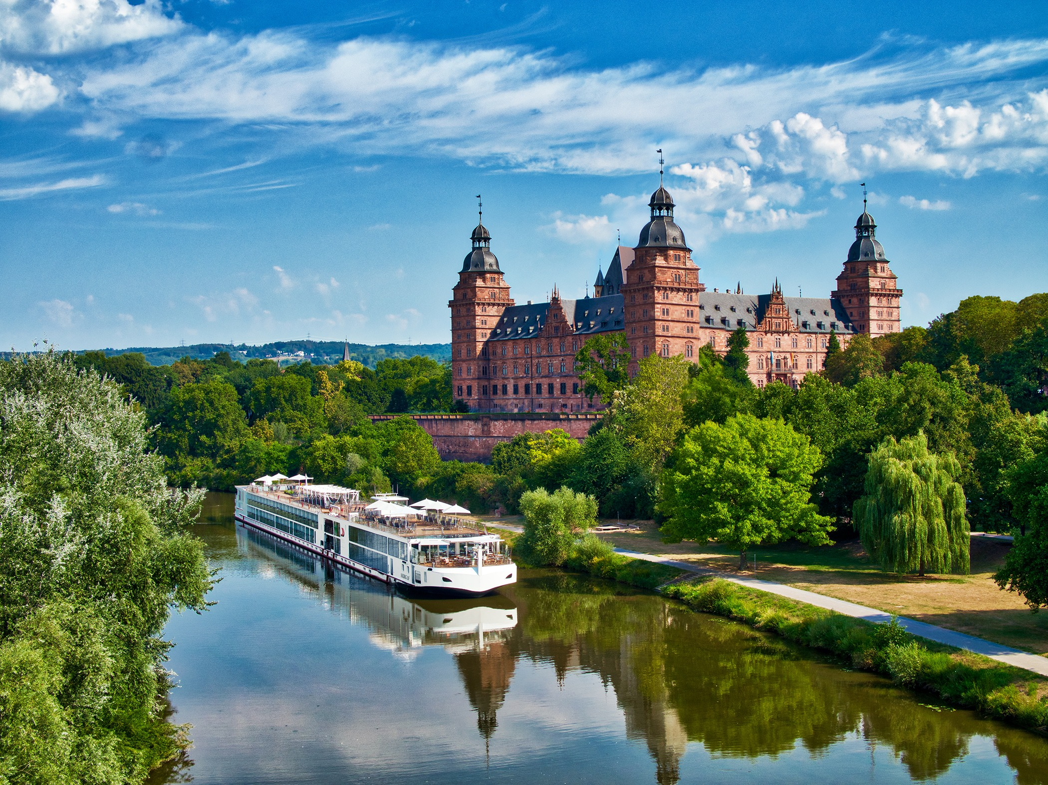 The Viking Longship Lif on the River Main near the Schloss Johannisburg, city of Aschaffenburg, Bavaria, Germany.