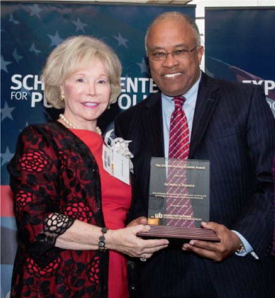 Nancy Grasmick and Kurt L. Schmoke with 2016 William Donald Schaefer Award Plaque